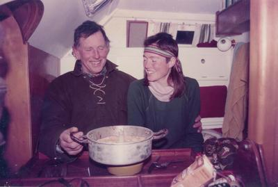 Photograph: Gerry Clark and person on yacht with a cake