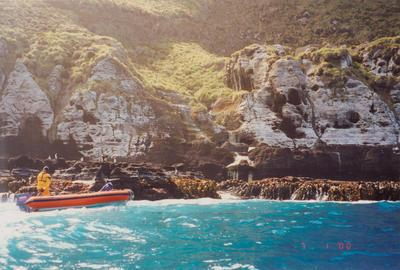 Photograph: Inflatable dingy near rocky shore