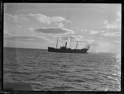 Glass Plate: Vessel at sea shillouetted against sky