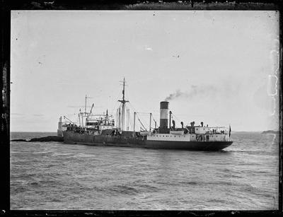 Glass Plate: Steam cargo vessel at sea near costal beacon
