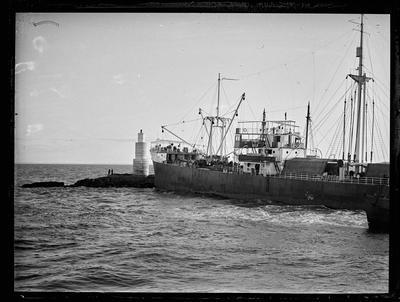 Glass Plate: Steam passenger vessel anchored near coastal beacon