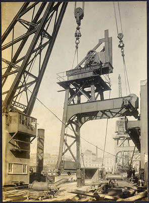 Photograph: Floating crane lifting semi-erected electric crane, 1912.