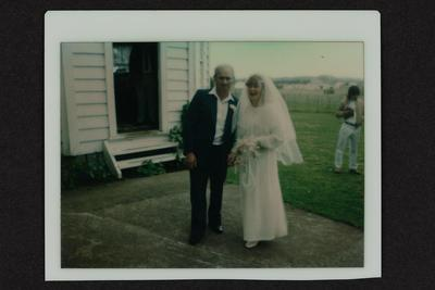 Photograph: Phillippa Were and William Were, standing outside a church on their wedding day, 17 Sept 1983