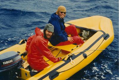 Photograph: Two men in inflatable dingy at sea