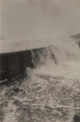 Photograph: RANGI (1905) view of wave coming over deck